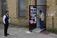 A voter leaves a polling station set up at the Estonian Club in Bradford on May 23, 2019, as voting for the European Parliament elections took place across the country. - Voting got under way in Britain early on Thursday in elections to the European Parliament -- a contest the country had not expected to hold nearly three years after the Brexit referendum. (Photo by Oli SCARFF / AFP)