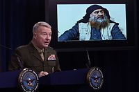 ARLINGTON, VIRGINIA - OCTOBER 30: U.S. Marine Corps Gen. Kenneth McKenzie, commander of U.S. Central Command, speaks as a picture of Abu Bakr al-Baghdadi is seen during a press briefing October 30, 2019 at the Pentagon in Arlington, Virginia. Gen. McKenzie and Hoffman spoke to the media to provide an update on the special operations raid that targeted former ISIS leader Abu Bakr al-Baghdadi in Idlib Province, Syria.   Alex Wong/Getty Images/AFP == FOR NEWSPAPERS, INTERNET, TELCOS & TELEVISION USE ONLY ==