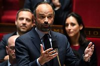 French Prime Minister Edouard Philippe gestures as he speaks during a session of questions to the government at the National Assembly in Paris on April 2, 2019. (Photo by Alain JOCARD / AFP)