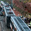 Officials and emergency personnel visit the site where a commuter train derailed in the town of Vacarisses, about 35 kilometres (20 miles) northeast of Barcelona, on November 20, 2018. - At least one person was killed and six injured in the accident caused by a landslide following heavy rains, emergency services and Spain's rail operator said. (Photo by Pau Barrena / AFP)