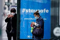 A commuter wearing a protective face mask waits for a bus at the Gare Bruxelles-Central train station on May 4, 2020 in Brussels, amid the spread of the COVID-19 pandemic caused by the novel coronavirus. (Photo by Kenzo TRIBOUILLARD / AFP)