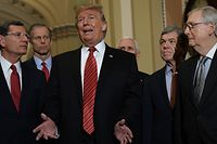 WASHINGTON, DC - JANUARY 09: U.S. President Donald Trump (3rd L) speaks to members of the media as (L-R) Sen. John Barrasso (R-WY), Sen. John Thune (R-SD), Vice President Mike Pence, Sen. Roy Blunt (R-MO), and Senate Majority Leader Sen. Mitch McConnell (R-KY) listen at the U.S. Capitol after the weekly Republican Senate policy luncheon January 09, 2019 in Washington, DC. Trump met with GOP lawmakers to shore up their resolve and support for his proposed border wall with Mexico as the partial federal government shutdown drags into a third week.   Alex Wong/Getty Images/AFP == FOR NEWSPAPERS, INTERNET, TELCOS & TELEVISION USE ONLY ==