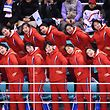 North Korea's cheerleaders cheer during the women's preliminary round ice hockey match between Switzerland and the Unified Korean team during the Pyeongchang 2018 Winter Olympic Games at the Kwandong Hockey Centre in Gangneung on February 10, 2018.   / AFP PHOTO / JUNG Yeon-Je