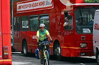 Ambulance Technician Nick Mars in central London traffic on his new bike ambulance launched by London Ambulance Service to beat London's road congestion Wednesday July 24, 2002.  The bike is equipped with life saving equipment and in trials reached people faster than ordinary vehicles 88% of the time. (AP Photo/Sang Tan)