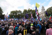 """Demonstrators with placards and EU and Union flags gather in Parliament Square in central London on October 19, 2019, as they take part in a rally by the People's Vote organisation calling for a final say in a second referendum on Brexit. - Thousands of people march to parliament calling for a """"People's Vote"""", with an option to reverse Brexit as MPs hold a debate on Prime Minister Boris Johnson's Brexit deal. (Photo by ISABEL INFANTES / AFP)"""