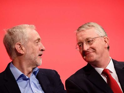 (FILES) This file photo taken on September 28, 2015 shows British opposition Labour Party Leader Jeremy Corbyn (L) as he speaks with with Shadow Foreign Secretary Hilary Benn on day two of the annual Labour party conference in Brighton, southern England. The future of opposition Labour leader Jeremy Corbyn looked shaky on June 26, 2016, after two members of his top team quit and others seemed set to follow over his handling of Britain's EU referendum. Corbyn sacked his foreign affairs spokesman, Hilary Benn, late Saturday after Benn said he no longer had confidence in his leadership, while health spokeswoman Heidi Alexander announced her resignation on Twitter Sunday. / AFP PHOTO / Leon NEAL