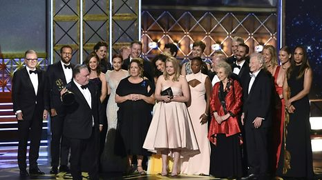 "The cast and crew of ""The Handmaid's Tale"" accept the award for Outstanding Drama Series for ""The Handmaid's Tale"" onstage during the 69th Emmy Awards at the Microsoft Theatre on September 17, 2017 in Los Angeles, California.   / AFP PHOTO / Frederic J. Brown"