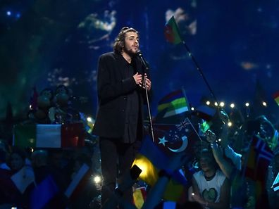 "Portuguese singer representing Portugal with the song ""Amar Pelos Dios"" Salvador Vilar Braamcamp Sobral aka Salvador Sobral performs during the final of the 62nd edition of the Eurovision Song Contest 2017 Grand Final at the International Exhibition Centre in Kiev, on May 13, 2017. Sobral won this year's Eurovision Song Contest. / AFP PHOTO / Sergei SUPINSKY"