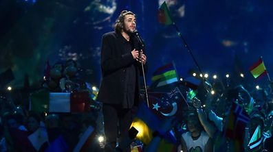"""Portuguese singer representing Portugal with the song """"Amar Pelos Dios"""" Salvador Vilar Braamcamp Sobral aka Salvador Sobral performs during the final of the 62nd edition of the Eurovision Song Contest 2017 Grand Final at the International Exhibition Centre in Kiev, on May 13, 2017. Sobral won this year's Eurovision Song Contest. / AFP PHOTO / Sergei SUPINSKY"""