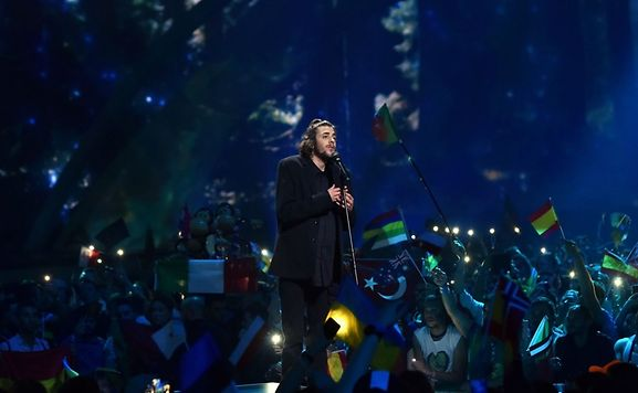 "Portuguese singer with the song ""Amar Pelos Dios"" Salvador Vilar Braamcamp Sobral aka Salvador Sobral performs during the final of the 62nd edition of the Eurovision Song Contest 2017 Grand Final at the International Exhibition Centre in Kiev, on May 13, 2017"