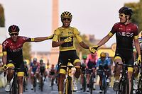 Spain's Jonathan Castroviejo (L) and Great Britain's Geraint Thomas (R) congratulate Colombia's Egan Bernal (C), wearing the overall leader's yellow jersey, as he celebrates his victory on the finish line of the 21st and last stage of the 106th edition of the Tour de France cycling race between Rambouillet and Paris Champs-Elysees, in Paris, in Paris on July 28, 2019. (Photo by Anne-Christine POUJOULAT / AFP)