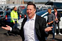 (FILES) This file photo taken on September 3, 2020 shows Tesla CEO Elon Musk gesturing as he arrives to visit the construction site of the future US electric car giant Tesla, in Gruenheide near Berlin. - The boom in demand for placing small satellites into orbit has boosted interest in small rockets, but industry players do not think the niche will become a business segment of its own. (Photo by Odd ANDERSEN / AFP)