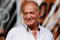 Spanish King Juan Carlos smiles during the prize giving ceremony of the 29th Copa del Rey yacht race in Palma de Mallorca in this August 7, 2010 file photo. The 75-year-old king has had a spectacular fall from grace as scandals undermine public approval and his health weakens. Public opinion has been soured by criminal charges against Juan Carlos' daughter and her husband in an embezzlement case, an unexplained Swiss bank account and a flamboyant lifestyle -- including a big-game hunting trip to Africa -- that jarred with the economic crisis engulfing the nation. Picture taken August 7, 2010. REUTERS/Enrique Calvo (SPAIN - Tags: ROYALS SPORT YACHTING)