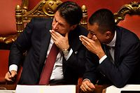 "TOPSHOT - Italian Prime Minister Giuseppe Conte (L) speaks with Deputy Prime Minister and Minister of Economic Development, Labour and Social Policies, Luigi Di Maio (R) after delivering a speech at the Italian Senate, in Rome, on August 20, 2019, as the country faces a political crisis. - Italy's Premier Conte says to offer resignation during his speech at the Senate after calling Italy's far-right Interior Minister Matteo Salvini ""irresponsible"" to spark a political crisis by pulling the plug on the governing coalition. (Photo by Andreas SOLARO / AFP)"