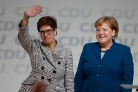 Germany's conservative Christian Democratic Union (CDU) newly elected leader Annegret Kramp-Karrenbauer is congratulated by German Chancellor Angela Merkel (R) during the CDU congress on December 7, 2018 at a fair hall in Hamburg, northern Germany. - Annegret Kramp-Karrenbauer, a close ally of German Chancellor Angela Merkel, on Friday won a party vote to succeed the veteran leader at the helm of the centre-right CDU. (Photo by Odd ANDERSEN / AFP)