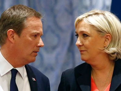 """Former French presidential election candidate for the right-wing Debout la France (DLF) party Nicolas Dupont-Aignan (L) and French presidential election candidate for the far-right Front National (FN) party Marine Le Pen, look at each other upon their arrival for a joint statement at FN headquarters in Paris, on April 29, 2017. Dupont-Aignan, who arrived on the sixth position with 4.7% of the votes during the first round of the presidential election, announced on April 28, 2017 that """"he endorses"""" Marine Le Pen for the second round of the election. The candidate of the FN declared that she will appoint Dupont-Aignan as Prime minister if she will be elected. / AFP PHOTO / GEOFFROY VAN DER HASSELT"""