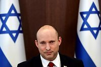 Israeli Prime Minister Naftali Bennett poses for a picture during the weekly cabinet meeting in Jerusalem on July 11, 2021. (Photo by RONEN ZVULUN / POOL / AFP)