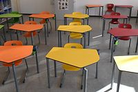 An empty classroom in a primary school in Eichenau near Munich, southern Germany, is pictured on December 18, 2020, amid the ongoing novel coronavirus Covid-19 pandemic. - Long held up as a European success story in the fight against the pandemic, Germany has been hit hard by a second coronavirus wave that has brought record daily infection numbers and deaths. Crisis talks between German Chancellor Angela Merkel and regional leaders saw the country return to a partial lockdown on Wednesday, December 16, 2020, shutting schools and non-essential shops in addition to the existing restrictions, until at least January 10, 2021. (Photo by Christof STACHE / AFP)