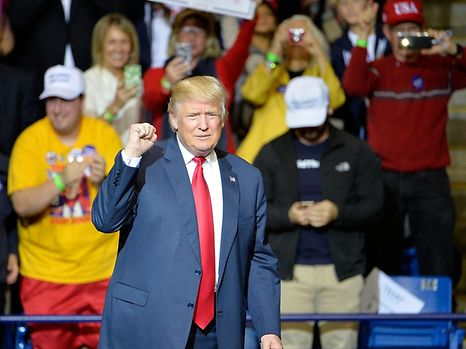 FAYETTEVILLE, NC - DECEMBER 06: President-elect Donald Trump pumps his fist to cheers at Crown Coliseum on December 6, 2016 in Fayetteville, North Carolina. Trump took time off from selecting the cabinet for his incoming administration to celebrate his victory in the general election.   Sara D. Davis/Getty Images/AFP == FOR NEWSPAPERS, INTERNET, TELCOS & TELEVISION USE ONLY ==