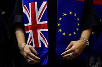 (FILES) In this file photograph taken on January 29, 2020, British members of the European Parliament from the Group of the Progressive Alliance of Socialists and Democrats pose for a group picture wearing scarves depicting the European Union and the Union Jack flags at The Europa Building in Brussels. - EU chief Ursula von der Leyen declared October 1, 2020,  that Brussels is taking legal action over the British government's attempt to overturn parts of the Brexit withdrawal agreement. (Photo by JOHN THYS / AFP)