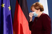 22.11.2020, Berlin: Bundeskanzlerin Angela Merkel (CDU) verlässt eine gemeinsame Pressekonferenz mit Bundesfinanzminister Scholz zum virtuellen G20-Gipfeltreffen. Foto: Hannibal Hanschke/Reuters-Pool/dpa +++ dpa-Bildfunk +++