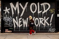 """NEW YORK, NY - APRIL 16: A person walks by a closed business on April 16, 2020, in New York City. New York State Governor Andrew Cuomo announced during his daily COVID-19 briefing that the """"New York State on PAUSE"""" order will be extended until May 15, and shared plans to allow business to reopen in what he is calling a phased priority scale based on the risks posed.   David Dee Delgado/Getty Images/AFP == FOR NEWSPAPERS, INTERNET, TELCOS & TELEVISION USE ONLY =="""