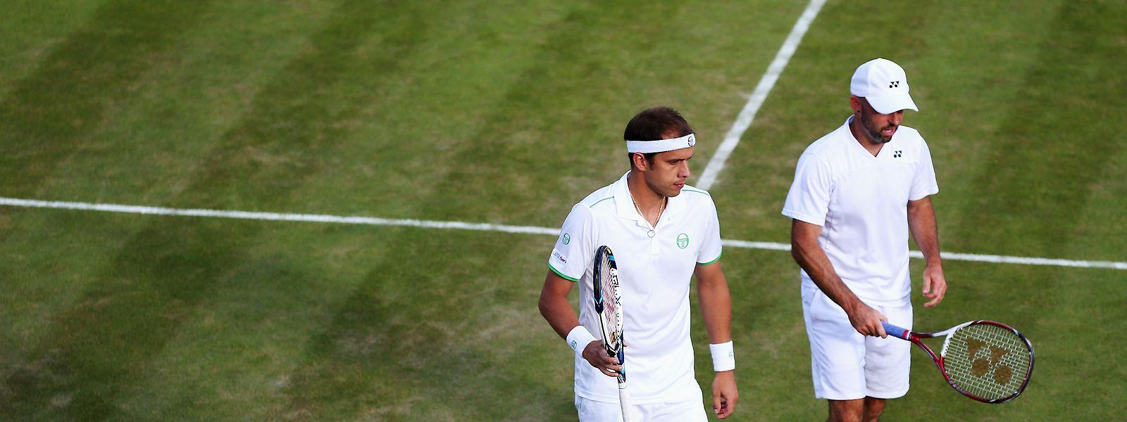 Jamie Delgado (r.) war zwei Jahre lang Coach von Gilles Muller. Beide spielten auch regelmäßig im Doppel zusammen, hier 2014 in Wimbledon.