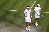 LONDON, ENGLAND - JUNE 27:  Jamie Delgado of Great Britain and Giles Muller of Luxembourg during their Gentlemen's Doubles second round match against John Peers of Australia and Jamie Murray of Great Britain on day five of the Wimbledon Lawn Tennis Championships at the All England Lawn Tennis and Croquet Club on June 27, 2014 in London, England.  (Photo by Steve Bardens/Getty Images)