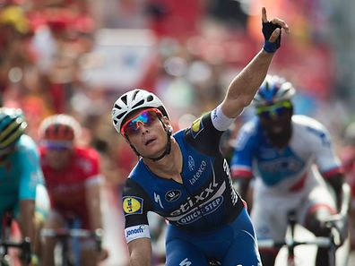 "Etixx-Quickstep' Begium cyclist Gianni Meersman celebrates winning as he crosses the finish line during the fifth stage of the 71st edition of ""La Vuelta"" Tour of Spain, a 171.3 km route between Viveiro and Lugo, on August 23, 2016. / AFP PHOTO / JAIME REINA"