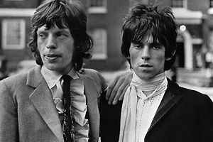 Original caption: London: Out on bail pending appeal of conviction and sentence on drug charges, rolling Stones Mich Jagger (l) and Keith Richard gained suport July 1 of the prestigious Times of London. Jagger, 23 year old leader of the singing group, was sentenced to three months in jail for possesion of pep pills. Richard got a year for permitting his home to be used for the smoking of marijuana. The Times said the sentence was overly harsh and suggested the performers might have been the victims of resentment by an older generation. 7/1/1967 London, England, UK