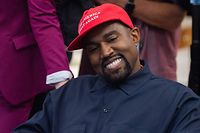 """(Files) in this file photo rapper Kanye West speaks during his meeting with US President Donald Trump in the Oval Office of the White House in Washington, DC, on October 11, 2018. - Kanye West, the entertainment mogul who urges listeners in one song to """"reach for the stars, so if you fall, you land on a cloud,"""" announced SJuly 4, 2020, he is challenging Donald Trump for the US presidency in 2020. (Photo by SAUL LOEB / AFP)"""