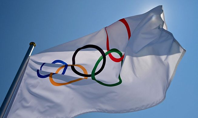 The Olympic flag waves at the Aomi Urban Sports Park ahead of the Tokyo 2020 Olympic Games in Tokyo on July 22, 2021.