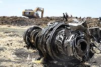 A photo shows debris of the crashed airplane of Ethiopia Airlines, near Bishoftu, a town some 60 kilometres southeast of Addis Ababa, Ethiopia, on March 11, 2019. - Airlines in Ethiopia, China and Indonesia grounded Boeing 737 MAX 8 jets Monday as investigators recovered the black boxes from a brand-new passenger jet that crashed outside Addis Ababa a day earlier, killing all 157 people on board. (Photo by Michael TEWELDE / AFP)