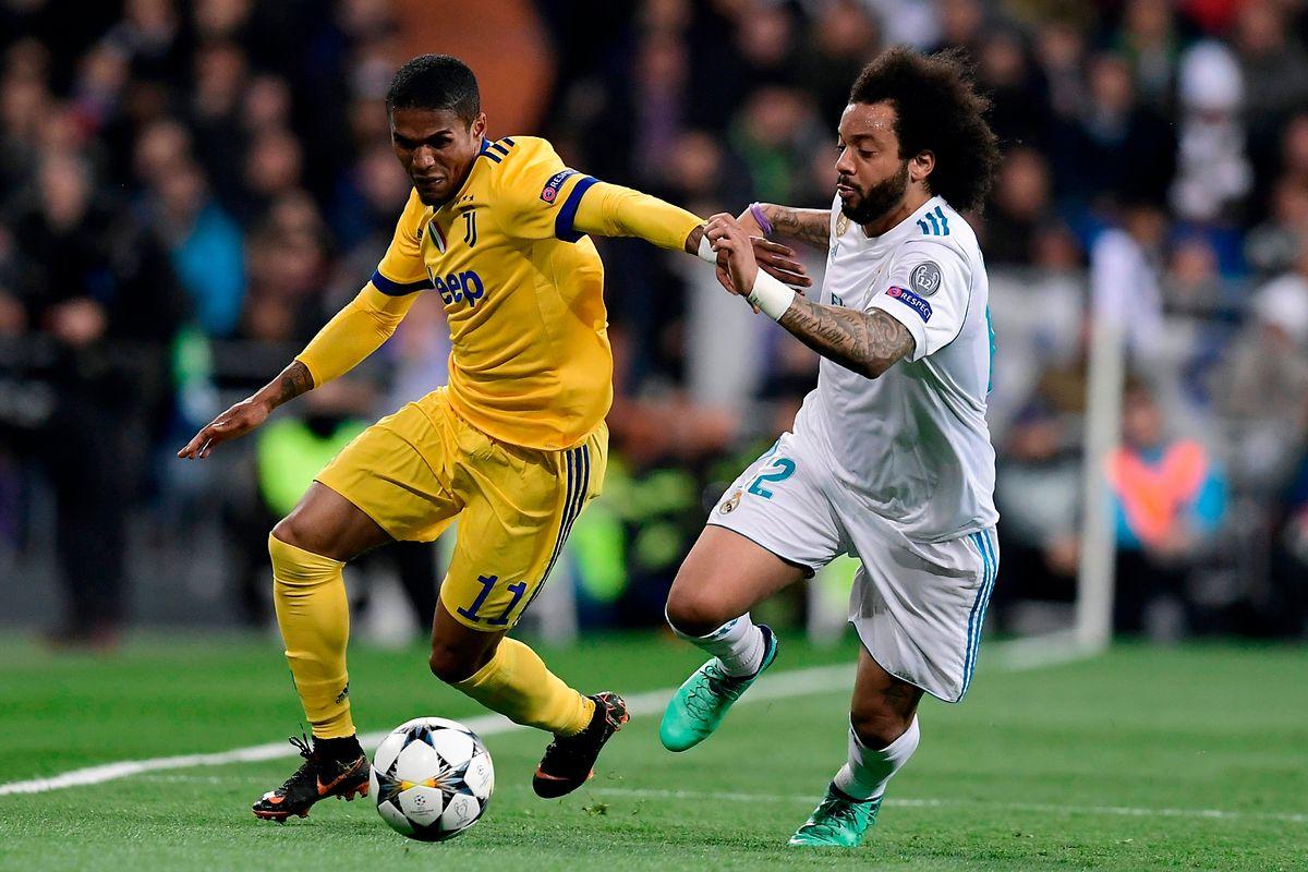 Der Titelverteidiger der Champions League lief fast nur hinterher, wie hier Marcelo (r.) gegen Douglas Costa.