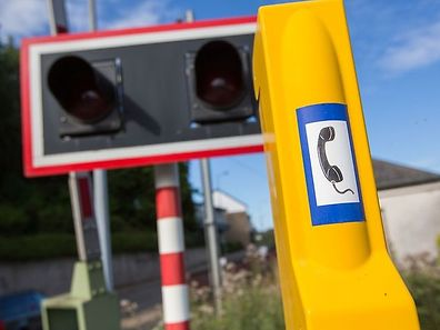 All railway crossings are equipped with a yellow emergency phone.