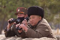"""This picture taken on March 9, 2020 and released from North Korea's official Korean Central News Agency (KCNA) on March 10, 2020 shows North Korean leader Kim Jong-Un (R) supervising a """"strike drill"""" together with a high ranking officer wearing a mask, a test of long-range multiple rocket launchers and tactical guided weapons, in an undisclosed location in North Korea. - North Korean leader Kim Jong Un has overseen another """"long-range artillery"""" drill, state media reported on Tuesday, a day after Japan said the nuclear-armed country had fired what appeared to be ballistic missiles. It was the second-such """"drill"""" in a week and comes as a prolonged hiatus in disarmament talks with the United States drags on. (Photo by STR / KCNA VIA KNS / AFP) / South Korea OUT / ---EDITORS NOTE--- RESTRICTED TO EDITORIAL USE - MANDATORY CREDIT """"AFP PHOTO/KCNA VIA KNS"""" - NO MARKETING NO ADVERTISING CAMPAIGNS - DISTRIBUTED AS A SERVICE TO CLIENTS / THIS PICTURE WAS MADE AVAILABLE BY A THIRD PARTY. AFP CAN NOT INDEPENDENTLY VERIFY THE AUTHENTICITY, LOCATION, DATE AND CONTENT OF THIS IMAGE --- /"""