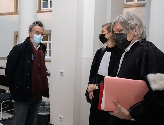 Paul Van Houtte, former EIB employee and his lawyers Esther Theyskens and Walter Van Steenbrugge