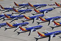 (FILES) In this file photo taken on March 28, 2019 Southwest Airlines Boeing 737 MAX aircraft are parked on the tarmac after being grounded, at the Southern California Logistics Airport in Victorville, California. - US air safety regulators could clear the Boeing 737 MAX to return to service before mid-year, a person close to the process said on January 24, 2020. Boeing shares rallied following a CNBC report that the Federal Aviation Administration signaled to airlines that the MAX could be approved to resume flights before mid-2020. (Photo by Mark RALSTON / AFP)