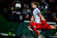Portugal's forward Cristiano Ronaldo vies with Luxembourg's midfielder Lars Gerson during the Euro 2020 qualifier group B football match between Portugal and Luxembourg at the Jose Alvalade stadium in Lisbon on October 11, 2019. (Photo by CARLOS COSTA / AFP)