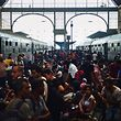TOPSHOTS Migrants and refugees crowd the platforms at the Keleti (eastern) railway station in Budapest on September 1, 2015. Keleti, the biggest Hungarian railway station was closed today as police evacuated people trying to get on trains bound for Germany. AFP PHOTO    / ATTILA KISBENEDEK