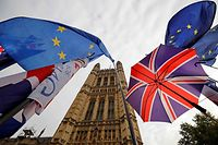 EU flag and Union flag-themed umbrellas of Brexit activists fly outside the Houses of Parliament in London on October 23, 2019. - British Prime Minister Boris Johnson could pivot towards a general election as the EU mulls granting a Brexit deadline extension on Wednesday, after a fresh twist to the divorce saga cast doubt over his hopes of leaving on October 31. In tense parliamentary votes on Tuesday, Johnson won initial backing for the divorce deal he agreed with the EU -- but MPs then rejected his timetable to rush it through parliament in a matter of days. (Photo by Tolga Akmen / AFP)