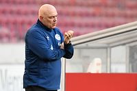 Schalke's Swiss headcoach Christian Gross reacts at the fifth goal during the German first division Bundesliga football match between VfB Stuttgart and Schalke 04 in Stuttgart, southwestern Germany, on February 27, 2021. (Photo by Thomas KIENZLE / various sources / AFP) / DFL REGULATIONS PROHIBIT ANY USE OF PHOTOGRAPHS AS IMAGE SEQUENCES AND/OR QUASI-VIDEO