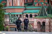 Russian policemen patrol Red Square with Saint Basil Cathedral in the background in central Moscow on May 17, 2020, during a strict lockdown in Russia to stop the spread of the novel coronavirus COVID-19. (Photo by Yuri KADOBNOV / AFP)