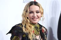 (FILES) In this file photo taken on December 9, 2016 Madonna attends the Billboard Women in Music 2016 event in New York City. Madonna on April 23, 2018 lost a nearly year-long bid to stop an auction of intimate items including a breakup letter from rap legend Tupac Shakur. A judge ruled that the Material Girl had directed her legal action against the wrong target in going after Darlene Lutz, a New York art dealer and former friend who helped Madonna build a collection before falling out with her.  / AFP PHOTO / ANGELA WEISS