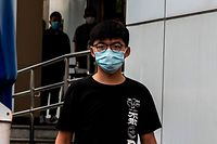 Pro-democracy activist Joshua Wong leaves Central police station in Hong Kong on September 24, 2020, after being arrested for unlawful assembly related to a 2019 protest against a government ban on face masks. (Photo by ISAAC LAWRENCE / AFP)