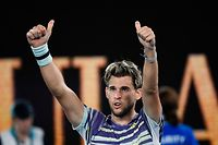 Austria's Dominic Thiem celebrates after victory against Germany's Alexander Zverev during their men's singles sem-final match on day twelve of the Australian Open tennis tournament in Melbourne on January 31, 2020. (Photo by Saeed KHAN / AFP) / IMAGE RESTRICTED TO EDITORIAL USE - STRICTLY NO COMMERCIAL USE