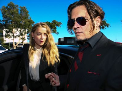 US actor Johnny Depp (R) and his wife Amber Heard