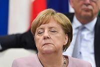 29.06.2019, Japan, Osaka: Bundeskanzlerin Angela Merkel (CDU) hat  während des Leader's Special Event on Women's Empowerment auf dem G20-Gipfel für einen Moment die Augen geschlossen. Foto: Lukas Coch/AAP/dpa +++ dpa-Bildfunk +++