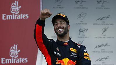 Red Bull Racing Formula One driver Daniel Ricciardo of Australia celebrates his victory.