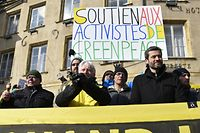 "Managing director of Greenpeace France, Jean-Fran�ois Julliard (R) and Responsible for the nuclear campaign of Greenpeace, Yannick Rousselet (L) demonstrate in front of the Thionville townhall, eastern France on February 27, 2018 on the opening day of a trial of eight activists and two heads of Greenpeace France for an action carried out inside the Cattenom nuclear power plant site in October 2017.  Charge with ""intrusion as a group and with degradaing the enclosure of a civil installation sheltering nuclear materials"", the militants incur five years of imprisonment and 75.000 euros of fine. General manager of Greenpeace France, Jean-Fran�ois Julliard today stated, ""We take onis for this action, we know it was illegal (...) but there was a very specific reason that was to denounce the security breaches,"". / AFP PHOTO / JEAN-CHRISTOPHE VERHAEGEN"